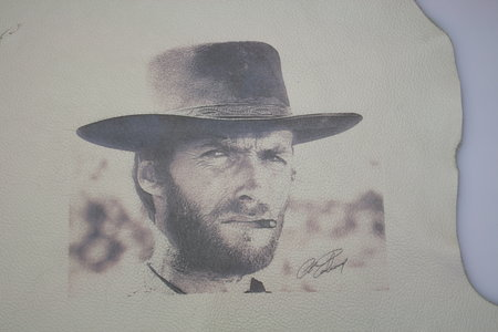 Etching of film star Clint Eastwood on leather.\\n\\n28/05/2018 08:38